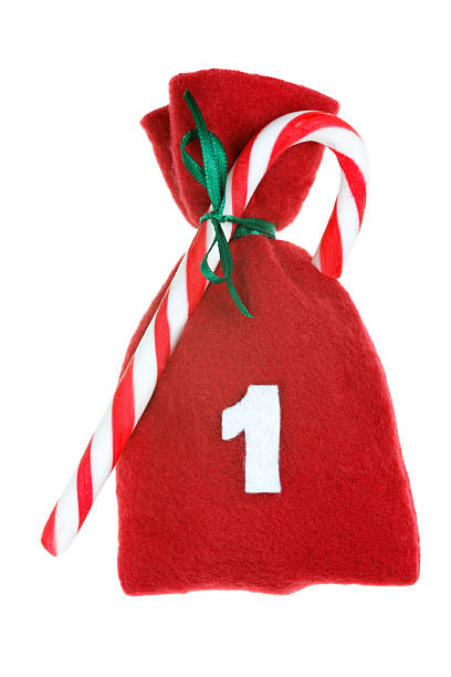 red Christmas bag for advent calendar isolated on white day 1